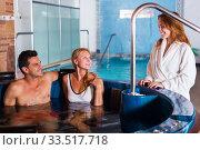 Купить «Friends relaxing in spa salon», фото № 33517718, снято 18 июля 2017 г. (c) Яков Филимонов / Фотобанк Лори