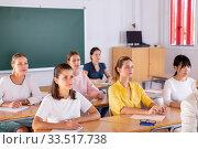 Купить «Students writing in notepads during lesson», фото № 33517738, снято 29 мая 2020 г. (c) Яков Филимонов / Фотобанк Лори