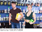 Купить «young people with purchases in shop of sports nutrition», фото № 33517834, снято 12 апреля 2018 г. (c) Яков Филимонов / Фотобанк Лори