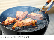 close up of barbecue meat roasting on grill. Стоковое фото, фотограф Syda Productions / Фотобанк Лори