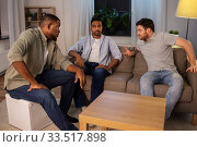 Купить «happy male friends talking at home at night», фото № 33517898, снято 28 декабря 2019 г. (c) Syda Productions / Фотобанк Лори