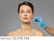 beautiful young woman and hand with scalpel. Стоковое фото, фотограф Syda Productions / Фотобанк Лори