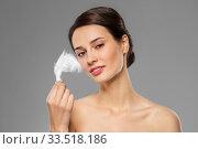 Купить «beautiful woman with feather touching her face», фото № 33518186, снято 30 ноября 2019 г. (c) Syda Productions / Фотобанк Лори