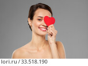 beautiful woman closing one eye with pink heart. Стоковое фото, фотограф Syda Productions / Фотобанк Лори