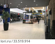 Berlin, Germany, Effects of the coronavirus: only a few people in the morning at the Tempelhofer Hafen shopping centre. Редакционное фото, агентство Caro Photoagency / Фотобанк Лори