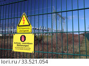 Купить «Nunsdorf, Germany, Signs - Artificial DNA - and - High Voltage Danger to life - at the fence of a transformer station», фото № 33521054, снято 22 марта 2020 г. (c) Caro Photoagency / Фотобанк Лори