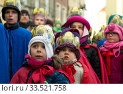 Купить «Poland, Poznan - Epiphany Day is officially celebrated at the Old Market Square. Two children dressed as kings.», фото № 33521758, снято 6 января 2017 г. (c) Caro Photoagency / Фотобанк Лори
