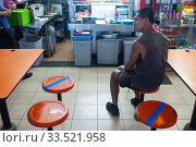 Singapore, Republic of Singapore, Social Distancing through taped stools in a catering area. Редакционное фото, агентство Caro Photoagency / Фотобанк Лори