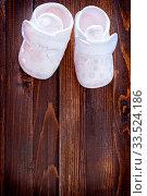 Купить «Little baby shoes», фото № 33524186, снято 8 июля 2020 г. (c) age Fotostock / Фотобанк Лори