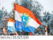 Flags of the Samara region fluttering against the blue sky. Стоковое фото, фотограф Акиньшин Владимир / Фотобанк Лори