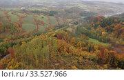 Купить «Picturesque autumn landscape with road between the hills. Czech Republic», видеоролик № 33527966, снято 18 октября 2019 г. (c) Яков Филимонов / Фотобанк Лори