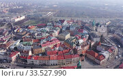 Купить «Aerial view of historic center of Lublin overlooking Dominican monastery and Catholic Archcathedral in spring day, Poland», видеоролик № 33527990, снято 10 марта 2020 г. (c) Яков Филимонов / Фотобанк Лори