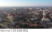 Купить «View from drone of modern Rzeszow cityscape in sunny spring day, Poland», видеоролик № 33528002, снято 10 марта 2020 г. (c) Яков Филимонов / Фотобанк Лори