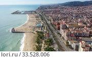 Купить «Scenic view from drone of large coastal Spanish town of Mataro on sunny winter day, Catalonia», видеоролик № 33528006, снято 24 ноября 2019 г. (c) Яков Филимонов / Фотобанк Лори