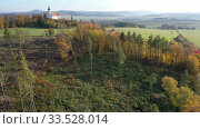Купить «Scenic autumn landscape with small Roman Catholic church on hilltop, Czech Republic», видеоролик № 33528014, снято 17 октября 2019 г. (c) Яков Филимонов / Фотобанк Лори