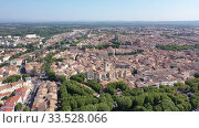 Купить «Scenic panoramic aerial view of residential areas of Narbonne with medieval Roman Catholic Cathedral on sunny summer day, France», видеоролик № 33528066, снято 30 августа 2019 г. (c) Яков Филимонов / Фотобанк Лори