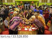 Купить «Chinese New Year 'lau yee-sang' dinner at Sungai Maong Community hall in Kuching, Sarawak, Malaysia», фото № 33528850, снято 21 февраля 2020 г. (c) age Fotostock / Фотобанк Лори