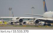Купить «Lufthansa Airbus A380 taxiing», видеоролик № 33533370, снято 19 июля 2017 г. (c) Игорь Жоров / Фотобанк Лори