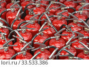 A lot of fire extinguishers. Protection and security concept background. Стоковое фото, фотограф Maksym Yemelyanov / Фотобанк Лори