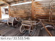 """Yard of a Siberian peasant with a wooden sled, Architectural and ethnographic Museum """"Taltsy"""", Irkutsk region, Eastern Siberia, Russia (2019 год). Редакционное фото, фотограф Наталья Волкова / Фотобанк Лори"""