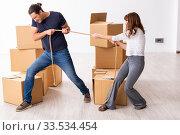 Купить «Young pair and many boxes in divorce settlement concept», фото № 33534454, снято 3 сентября 2019 г. (c) Elnur / Фотобанк Лори