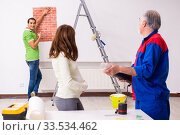 Купить «Young couple and old contractor in home renovation concept», фото № 33534462, снято 2 сентября 2019 г. (c) Elnur / Фотобанк Лори