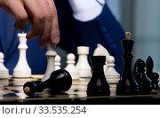 Купить «Businessman playing chess in strategy concept», фото № 33535254, снято 9 октября 2017 г. (c) Elnur / Фотобанк Лори