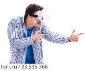 Купить «Young man wearing virtual reality VR glasses», фото № 33535366, снято 27 мая 2017 г. (c) Elnur / Фотобанк Лори
