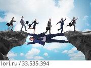 Купить «Businessman acting as a bridge in support concept», фото № 33535394, снято 27 мая 2020 г. (c) Elnur / Фотобанк Лори