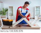 Купить «Super hero repairman working at home», фото № 33535570, снято 23 декабря 2016 г. (c) Elnur / Фотобанк Лори
