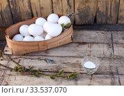 Chicken eggs in basket on wooden background. Стоковое фото, фотограф Дарья Филимонова / Фотобанк Лори