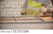 Купить «A man worker checking a metal frame for durability», видеоролик № 33537694, снято 6 июня 2020 г. (c) Константин Шишкин / Фотобанк Лори