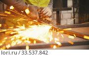 Купить «Man worker grinding the seams of an iron frame», видеоролик № 33537842, снято 29 мая 2020 г. (c) Константин Шишкин / Фотобанк Лори