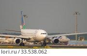Купить «Airbus A330 taxiing before departure», видеоролик № 33538062, снято 19 июля 2017 г. (c) Игорь Жоров / Фотобанк Лори