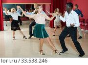 Купить «Young people dancing lindy hop in pairs in modern dance hall», фото № 33538246, снято 4 октября 2018 г. (c) Яков Филимонов / Фотобанк Лори
