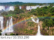 The concept of exotic and extreme tourism. Powerful waterfalls Iguazu - a recognized miracle of the world. Powerful two-stage waterfalsl creates watery dust and rainbow. Стоковое фото, фотограф Zoonar.com/kavram / easy Fotostock / Фотобанк Лори