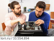 Two men repairing a desktop computer. Стоковое фото, фотограф Яков Филимонов / Фотобанк Лори