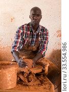 Купить «Potter working at pottery studio», фото № 33554986, снято 6 августа 2019 г. (c) Яков Филимонов / Фотобанк Лори