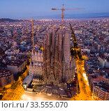 Barcelona, Spain - June 12, 2019: Basilica and Expiatory Church of the Holy Family by Gaudi at night from a drone. Sagrada Familia. Barcelona. Редакционное фото, фотограф Яков Филимонов / Фотобанк Лори