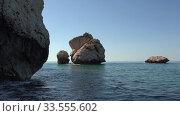 Купить «Aphrodite's Stone on Petra tou Romiou or Aphrodite Rock Beach, one of the main attractions and landmarks of Cyprus island.», видеоролик № 33555602, снято 5 апреля 2020 г. (c) Serg Zastavkin / Фотобанк Лори
