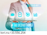 Купить «Conceptual hand writing showing Tax Deductions. Concept meaning reduction income that is able to be taxed of expenses», фото № 33556254, снято 6 августа 2020 г. (c) easy Fotostock / Фотобанк Лори