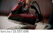 An iron filled with water for steam ironing. Стоковое видео, видеограф Константин Шишкин / Фотобанк Лори
