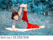 Купить «beautiful mature women with doing yoga in forest park On a summer day.», фото № 33559554, снято 9 августа 2019 г. (c) Акиньшин Владимир / Фотобанк Лори
