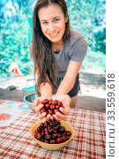 beautiful young woman washes cherries and eats. Стоковое фото, фотограф Акиньшин Владимир / Фотобанк Лори