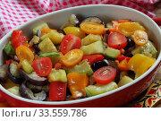 Купить «Vegetable stew with eggplant and zucchini on a wooden background», фото № 33559786, снято 15 апреля 2020 г. (c) Марина Володько / Фотобанк Лори