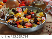 Купить «Vegetable stew with eggplant and zucchini on a wooden background», фото № 33559794, снято 15 апреля 2020 г. (c) Марина Володько / Фотобанк Лори