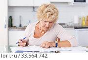 Купить «Woman put in order documents», фото № 33564742, снято 11 июля 2018 г. (c) Яков Филимонов / Фотобанк Лори