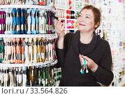 Купить «Woman buying mouline», фото № 33564826, снято 10 мая 2017 г. (c) Яков Филимонов / Фотобанк Лори