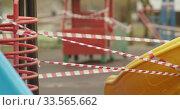 Empty playgrounds covered with a protective tape during quarantine of coronavirus, covid-19 virus. Редакционное видео, видеограф Aleksandr Lutcenko / Фотобанк Лори