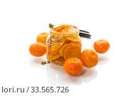 Купить «tangerine jam in a glass jar isolated on white background», фото № 33565726, снято 16 апреля 2020 г. (c) Peredniankina / Фотобанк Лори